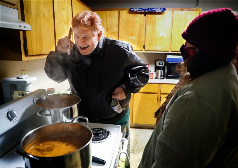 <strong>Lunches &rsquo;N Love outreach ministries&rsquo; volunteer Patrick Earl (left) cooks chili that will accompany warm clothes and supplies handed out to the needy on Friday, Dec. 25, 2020.</strong> (Mark Weber/The Daily Memphian)