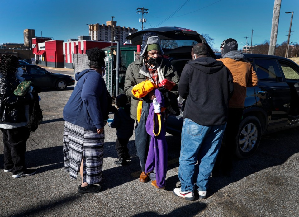 <strong>James Tate (middle) selects garments during Lunches &rsquo;N Love outreach ministries&rsquo; donation to the needy event on Friday, Dec. 25, 2020.</strong> (Mark Weber/The Daily Memphian)