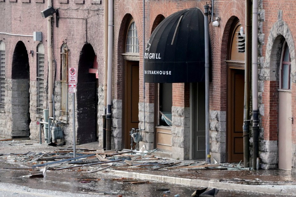 <strong>Debris is scattered near the scene of an explosion in downtown Nashville,&nbsp; Friday, Dec. 25, 2020. Buildings shook in the immediate area and beyond after a loud boom was heard early Christmas morning.</strong> (Mark Humphrey/AP)