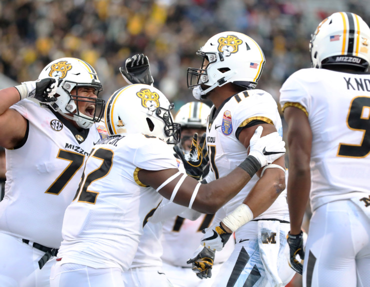 <strong>The University of Missouri Tigers celebrate after scoring a touchdown against the Oklahoma State Cowboys in the AutoZone Liberty Bowl game on Dec. 31, 2018.</strong> (Houston Cofield/Daily Memphian)
