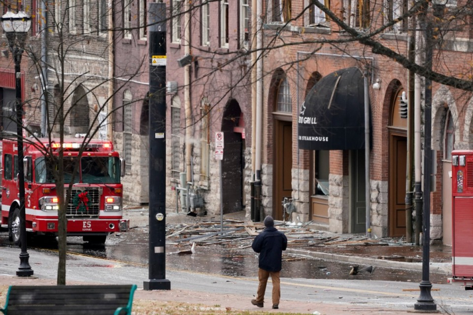 <strong>Debris scattered near the scene of an explosion in downtown Nashville, Friday, Dec. 25, 2020. Buildings shook in the immediate area and beyond after a loud boom was heard early Christmas morning.</strong> (Mark Humphrey/AP)