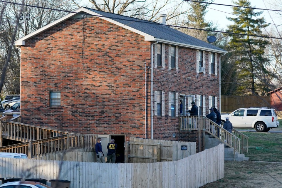 <strong>FBI and ATF agents search a home Saturday, Dec. 26, 2020, near Nashville. An explosion that shook the largely deserted streets of downtown Nashville early Christmas morning shattered windows, damaged buildings, and wounded three people. Authorities said they believed the blast was intentional.</strong> (Mark Humphrey/AP)