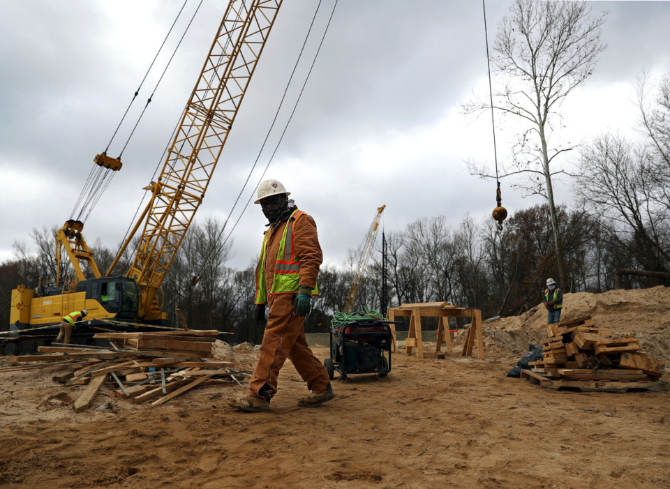 <strong>Construction crews work to build a bridge over the Wolf River near the I-240 exchange Dec. 16, 2020.</strong> (Patrick Lantrip/Daily Memphian)