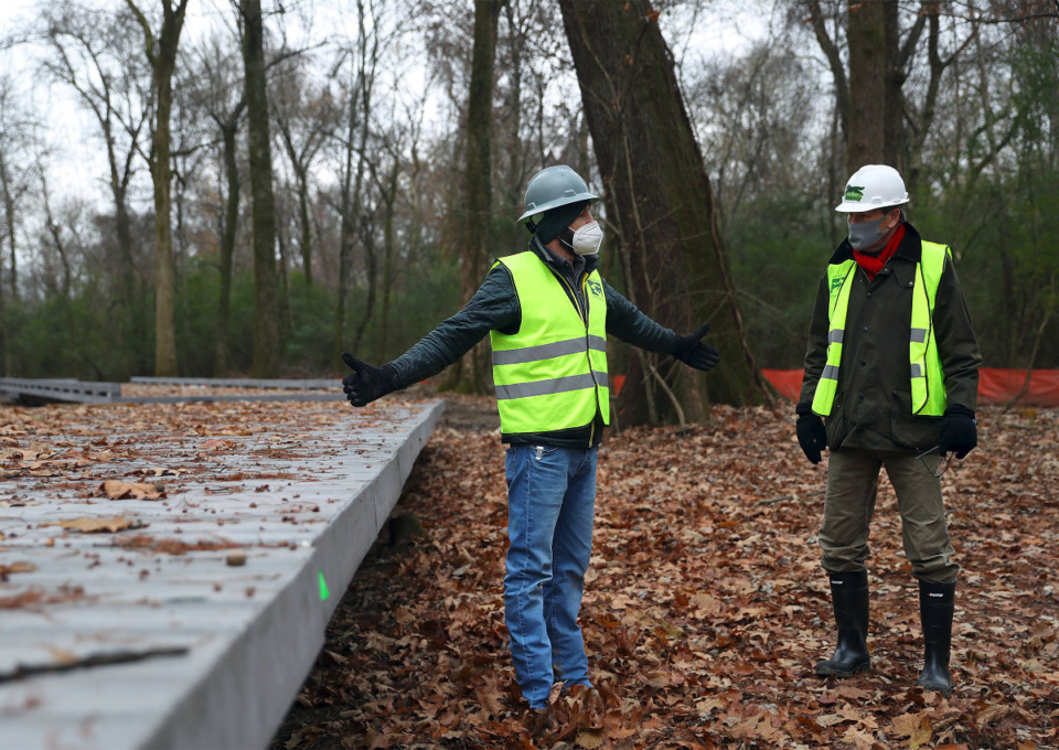 <strong>Findley Frazer (left) and Keith Cole with the Wolf River Conservancy give a tour of the elevated walkway being constructed through the Lucius Burch State Natural Area, Dec. 16, 2020.</strong> (Patrick Lantrip/Daily Memphian)