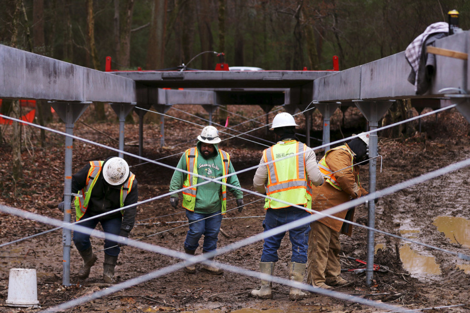 <strong>Construction crew work to build an elevated section of the Wolf River Greenway through the Lucius Burch State Natural Area Dec. 16, 2020.</strong> (Patrick Lantrip/Daily Memphian)