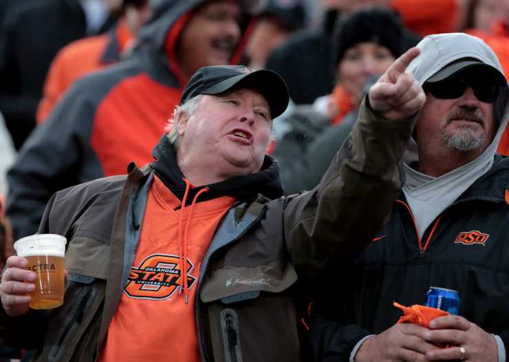 <strong>Oklahoma State fans yell at a referee during the AutoZone Liberty Bowl game against the Missouri Tigers on Dec. 31, 2018.</strong> (Houston Cofield/Daily Memphian)