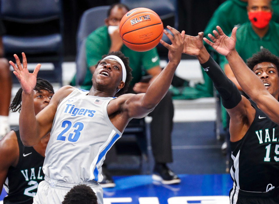 <strong>Memphis forward Malcolm Dandridge (left) looks to grab a rebound against the Mississippi Valley State defense during action on Tuesday, Dec. 8, 2020.</strong> (Mark Weber/The Daily Memphian)