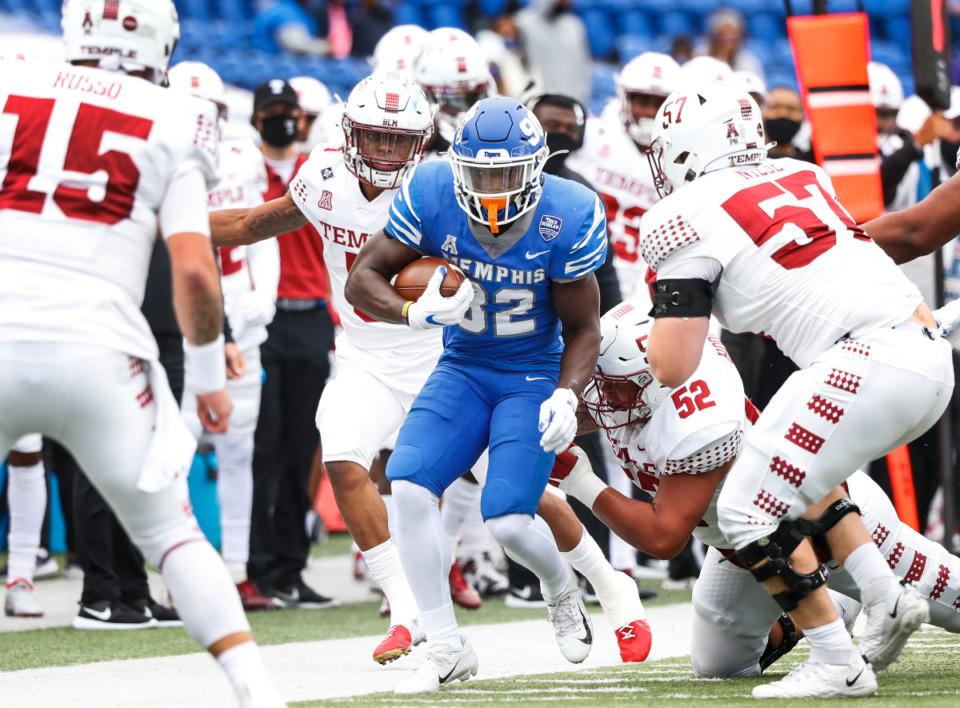 <strong>Memphis defender Jacobi Francis (middle) returns an interception against the Temple defense during action on Saturday, Oct. 24, 2020 at Liberty Bowl Memorial Stadium.</strong> (Mark Weber/The Daily Memphian file)