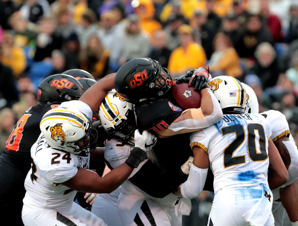 <strong>Oklahoma State running back Chubba Hubbard (30) gets tackled by a sea of Missouri defensive linemen during the AutoZone Liberty Bowl game on Dec. 31, 2018.</strong> (Houston Cofield/Daily Memphian)