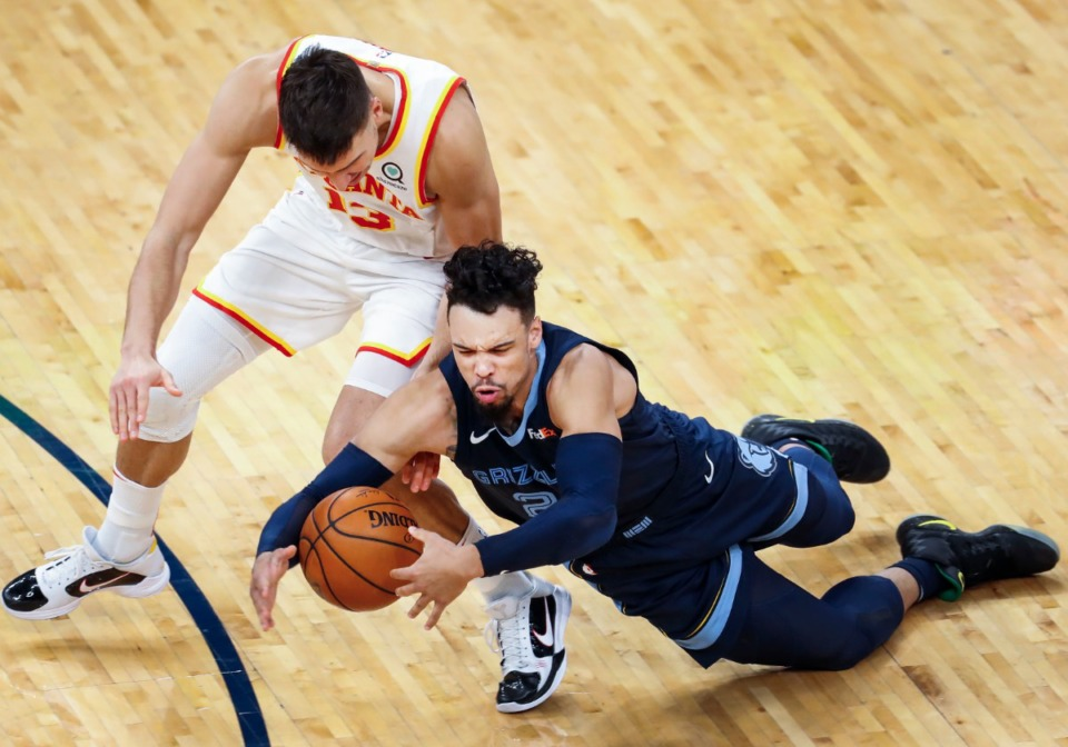 <strong>Memphis Grizzlies guard Dillion Brooks (right) battles for a loose ball with Atlanta Hawks guard Bogdan Bogdanovic (left) during action on Saturday, Dec. 26, 2020.</strong> (Mark Weber/The Daily Memphian)