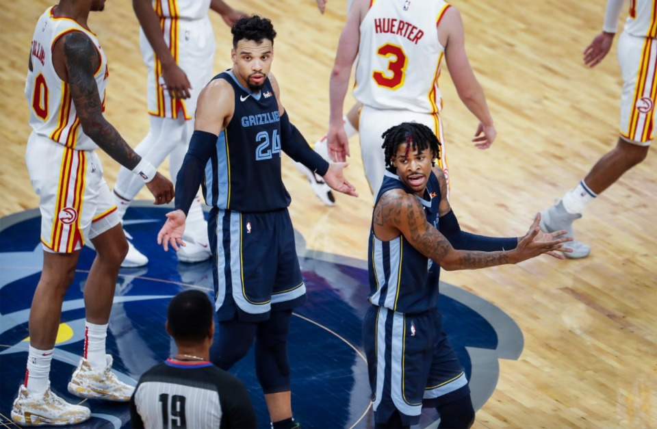 <strong>Memphis Grizzlies guard Ja Morant (right) reacts after being called for a technical foul as teammate Dillion Brooks (middle) looks on during the final minutes of action against the Atlanta Hawks on Saturday, Dec. 26, 2020.</strong> (Mark Weber/The Daily Memphian)