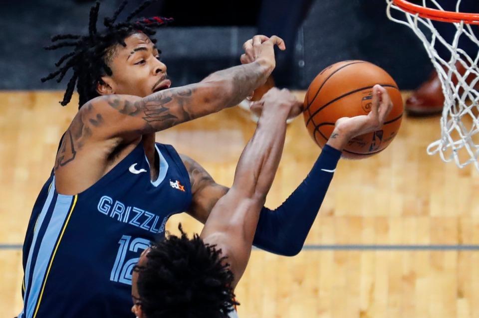 <strong>Memphis Grizzlies guard Ja Morant drives the lane against the Atlanta Hawks defense during action on Saturday, Dec. 26, 2020.</strong> (Mark Weber/The Daily Memphian)