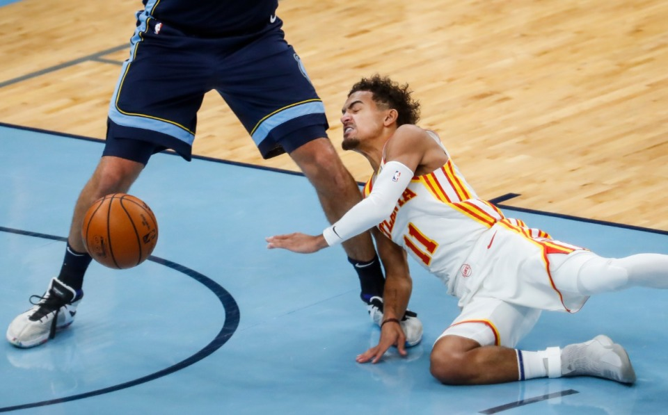 <strong>Atlanta Hawks guard Trae Young runs into the legs of Memphis Grizzlies defender Jonas Valanciunas after losing control of the ball during action on Saturday, Dec. 26, 2020.</strong> (Mark Weber/The Daily Memphian)