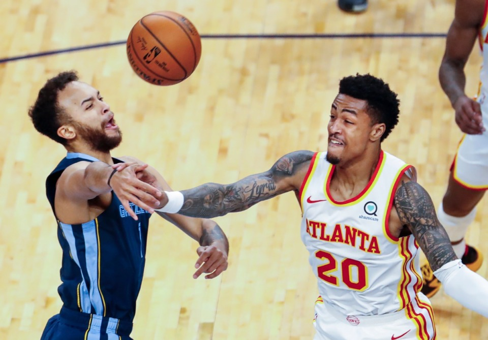 <strong>Memphis Grizzlies forward Kyle Anderson (left) is fouled by Atlanta Hawks defender John Collins (right) during action on Saturday, Dec. 26, 2020.</strong> (Mark Weber/The Daily Memphian)