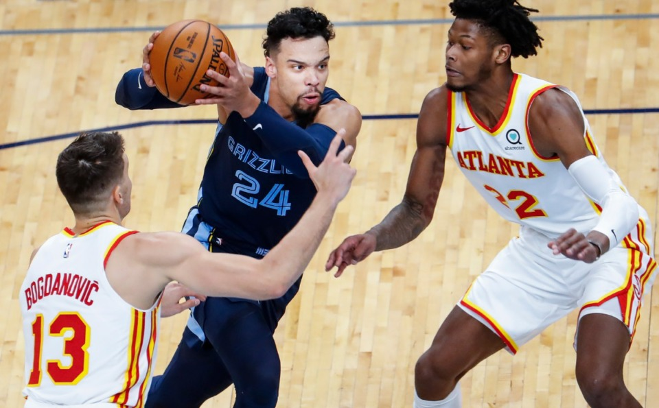 <strong>Memphis Grizzlies guard Dillon Brooks (middle) drives the lane against Atlanta Hawks defenders Bogdan Bogdanovic (left) and Cam Reddish (right) during action on Saturday, Dec. 26, 2020.</strong> (Mark Weber/The Daily Memphian)