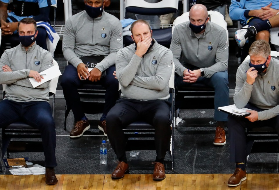 <strong>Memphis Grizzlies head coach Taylor Jenkins (middle) watch action against Atlanta Hawks from the bench on Saturday, Dec. 26, 2020.</strong> (Mark Weber/The Daily Memphian)