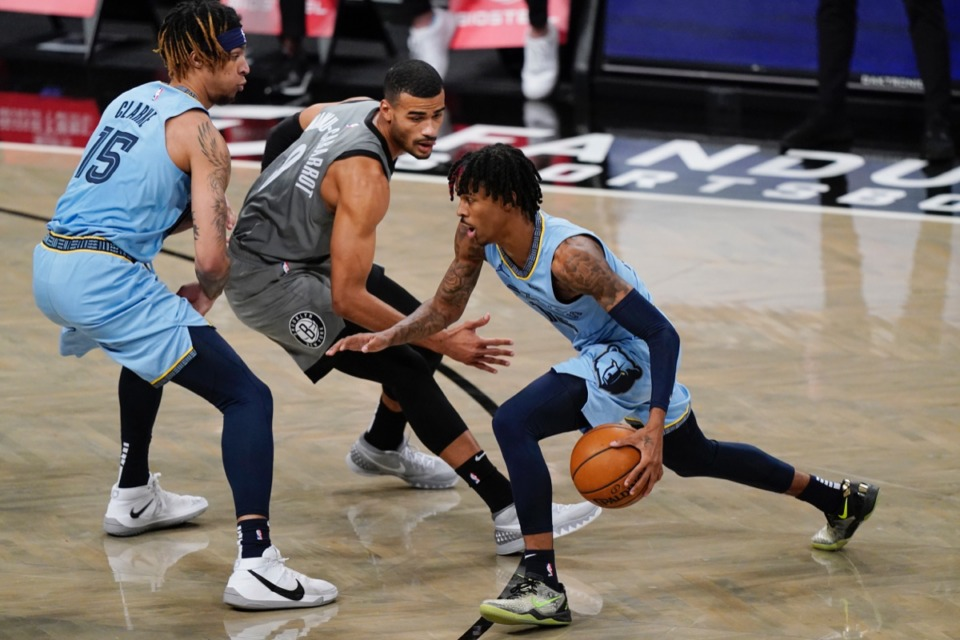 <strong>Grizzlies guard Ja Morant, right, drives past Brooklyn Nets guard Timothe Luwawu-Cabarrot (9) Monday, Dec. 28, 2020, before getting injured.</strong> (Kathy Willens/AP)