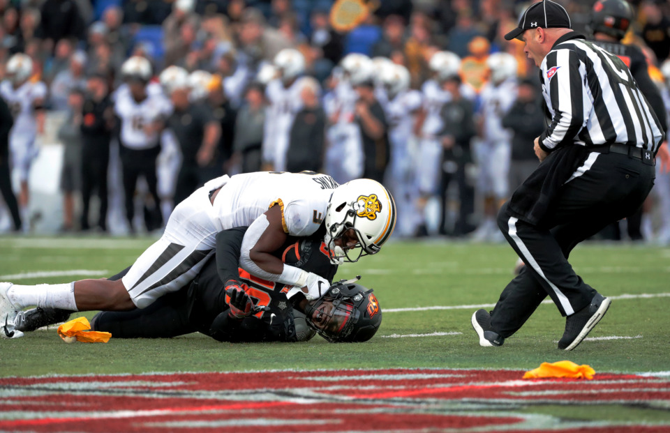 <strong>Missouri safety Ronnell Perkins (3) gets called for holding after pinning down Oklahoma State safety Za'Carrius Green in the AutoZone Liberty Bowl game on Dec. 31, 2018. Oklahoma State held off Mizzou to win 38-33.</strong> (Houston Cofield/Daily Memphian)