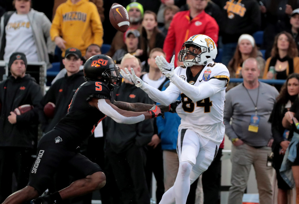 <strong>Missouri wide receiver Emmanuel Hall (84) reaches out to catch a pass while being guarded by Oklahoma State Cowboys defensive back Kemah Siverand (5) in the AutoZone Liberty Bowl game Dec. 31, 2018. Oklahoma State held off a fourth-quarter rally to beat Mizzou 38-33.</strong> (Houston Cofield/Daily Memphian)