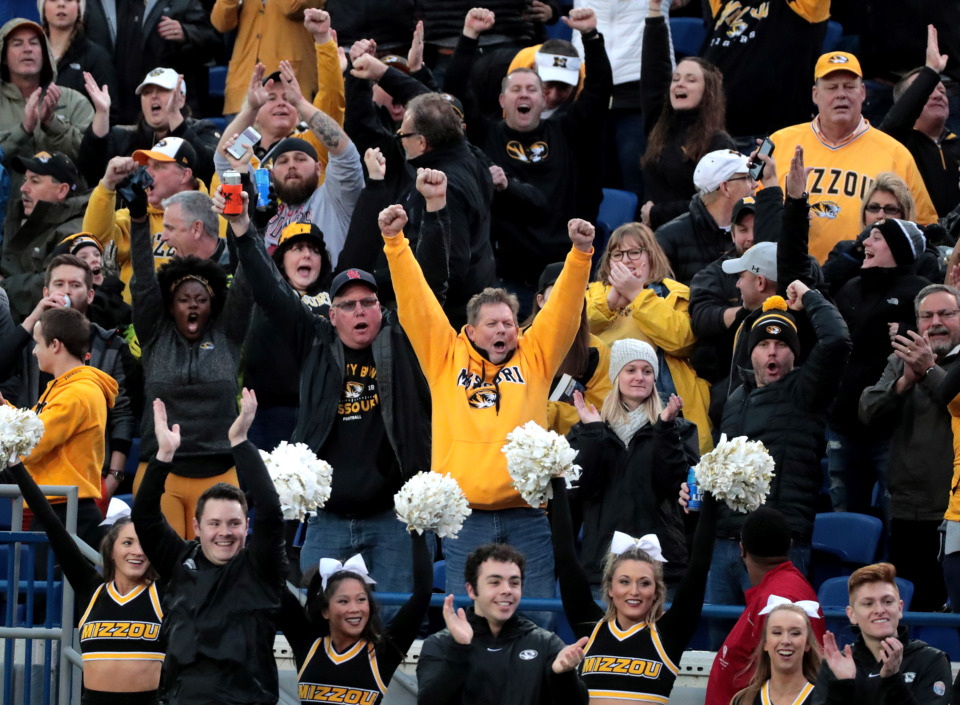 <strong>Missouri fans celebrate after the Tigers score a touchdown against Oklahoma State in the AutoZone Liberty Bowl on Dec. 31, 2018. Mizzou went into halftime leading 16-14 but ultimately fell to the Cowboys 38-33.</strong> (Houston Cofield/Daily Memphian)