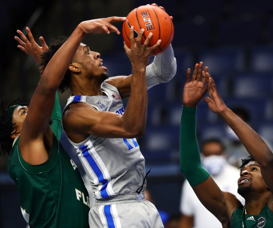 <strong>University of Memphis forward Deandre Williams (12) drives to the basket during a home game against the University of South Florida on Dec. 29, 2020.</strong> (Patrick Lantrip/Daily Memphian)