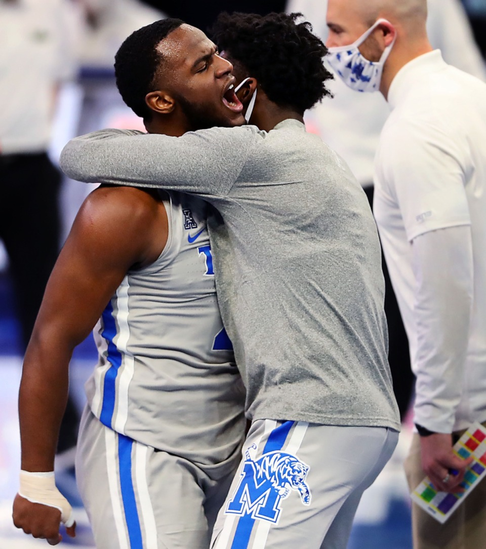 <strong>University of Memphis guard Alex Lomax (2) celebrates with teammates after making a game-saving stop during a home game against the University of South Florida on Dec. 29, 2020.</strong> (Patrick Lantrip/Daily Memphian)