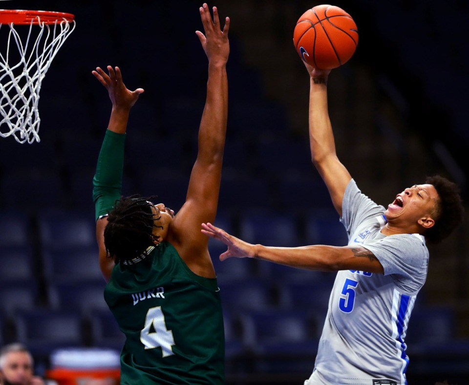<strong>University of Memphis guard Boogie Ellis (5) goes up for a layup during a home game against the University of South Florida Dec. 29, 2020.</strong> (Patrick Lantrip/Daily Memphian)