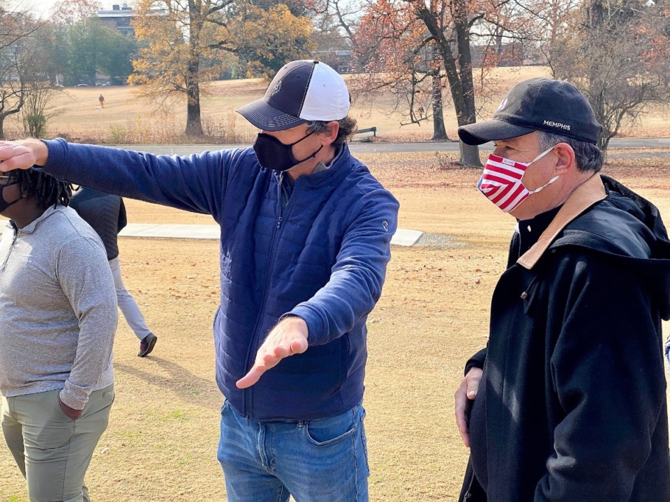 <strong>Golf course designer Rob Collins shows PGA pro Loren Roberts how the ground around No. 3 green will be reshaped in the redesign of Overton Park golf course.</strong> (Tom Bailey/Daily Memphian)
