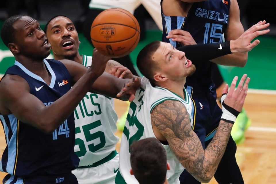 <strong>Memphis Grizzlies' Gorgui Dieng (14) battles for a rebound against&nbsp;Boston&rsquo;s Jeff Teague (55) and Daniel Theis (27) on Wednesday, Dec. 30, 2020, in Boston.</strong> (Michael Dwyer/AP)