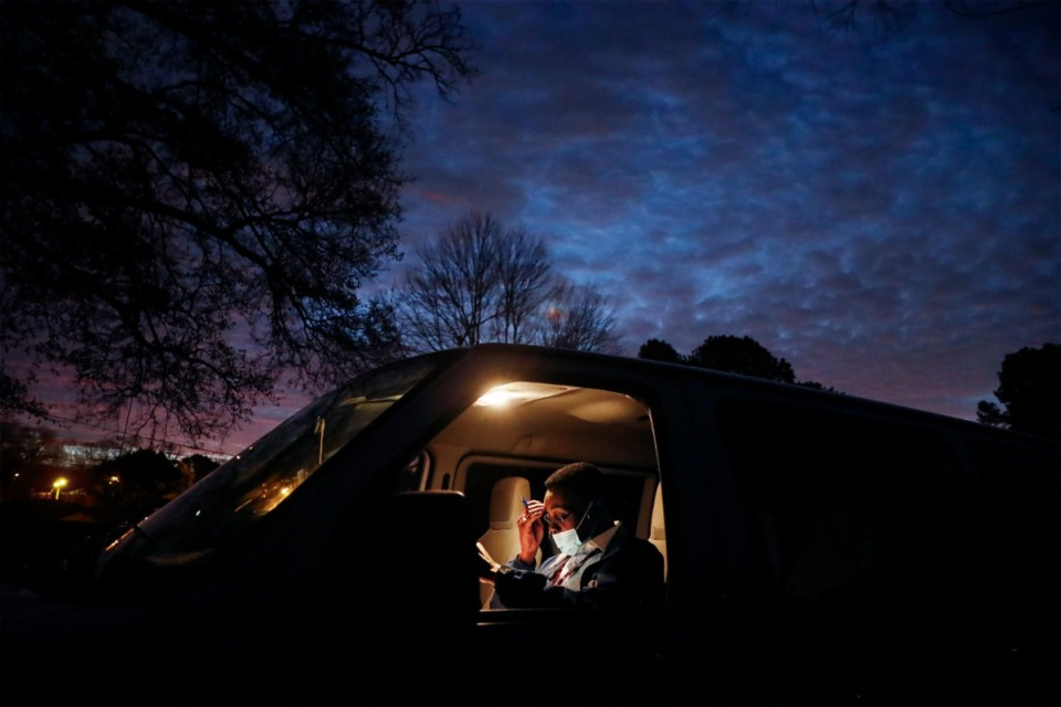 <strong>Alpha Omega Veterans Services transportation driver and resident Robert Porter completes paperwork before dawn on Monday, Dec. 28, 2020. Porter an Army veteran, has lived at the facility for over 11 years.</strong> (Mark Weber/The Daily Memphian)