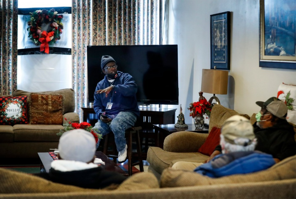 <strong>Alpha Omega Veterans Services program manager Kevin Ferrell, (top) himself a former homeless veteran, leads a group support session on Tuesday, Dec. 29, 2020.</strong> (Mark Weber/The Daily Memphian)