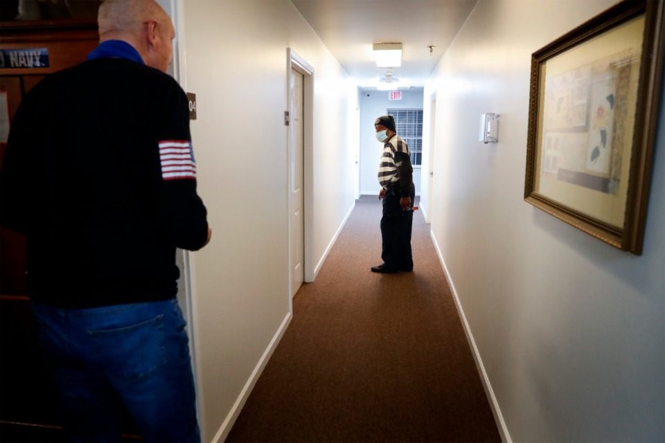 <strong>Navy veterans and neighbors Chris Oldham (left) and Terrence Motlow visit outside their rooms at the Alpha Omega Veterans Services&rsquo; Ball Street facility on Monday, Dec. 28, 2020.</strong> (Mark Weber/The Daily Memphian)