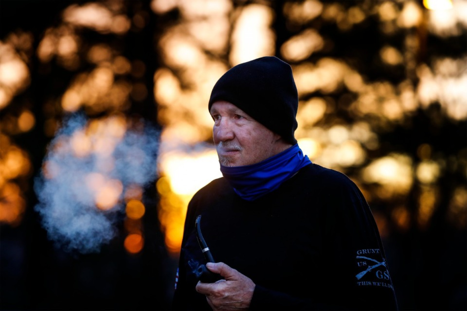 <strong>Navy veteran Chris Oldham takes a pre-dawn smoke break at the Alpha Omega Veterans Services&rsquo; Ball Street facility on Monday, Dec. 28, 2020.</strong> (Mark Weber/The Daily Memphian)