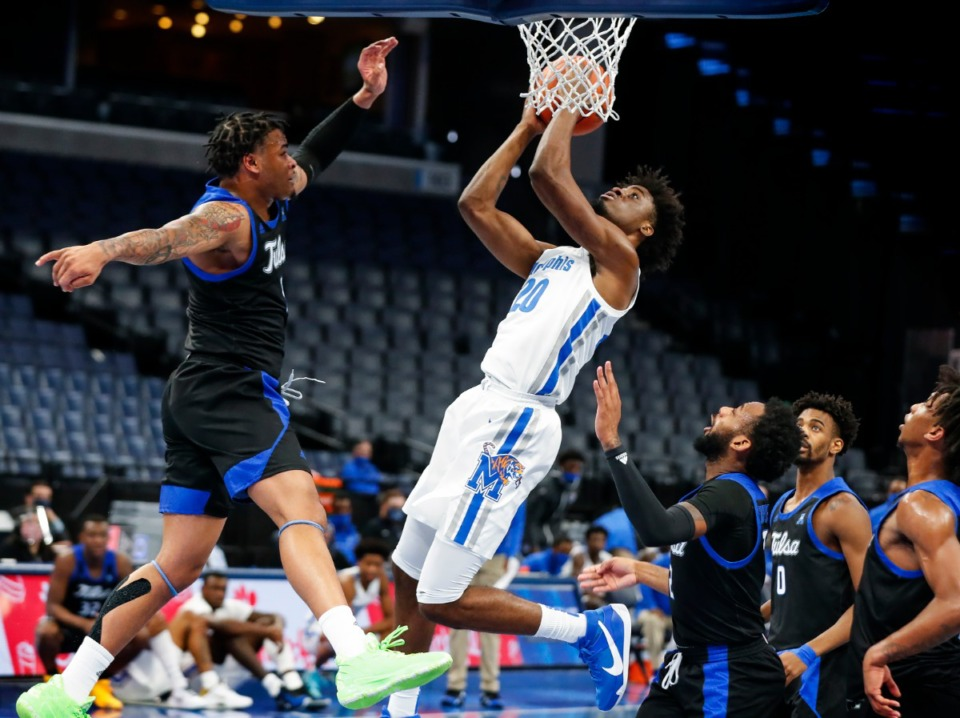 <strong>Memphis forward Ahmad Rand (middle) goes up for a lay-up against the Tulsa defense during action on Monday, Dec. 21, 2020.</strong> (Mark Weber/The Daily Memphian)