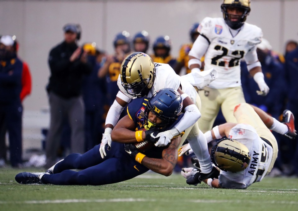 <strong>University of West Virginia receiver Sam Brown (17) get tackled during the AutoZone Liberty Bowl on Dec. 31, 2020.</strong> (Patrick Lantrip/Daily Memphian)