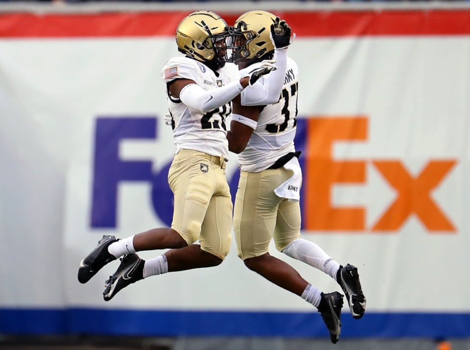 <strong>Army players Marquel Broughton (20) and Hamilton Baker (37) celebrate after a defensive play during the AutoZone Liberty Bowl on Dec. 31, 2020.</strong> (Patrick Lantrip/Daily Memphian)