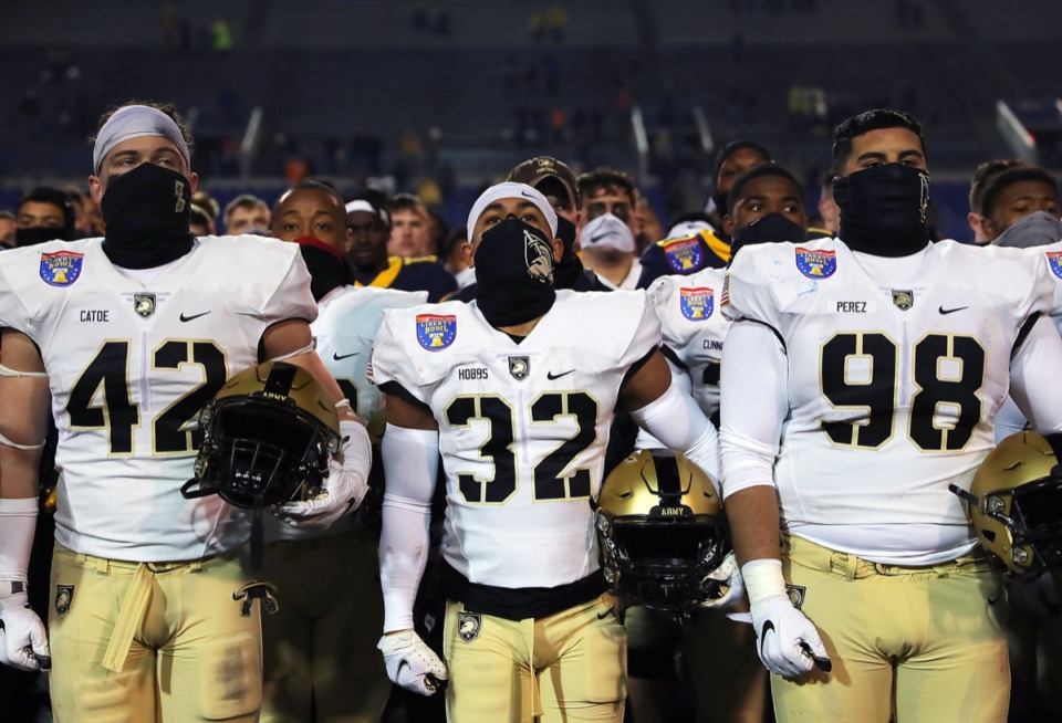 <strong>Army players sing to the fans after a 21-24 loss to West Virginia in the AutoZone Liberty Bowl on Dec. 31, 2020.</strong> (Patrick Lantrip/Daily Memphian)