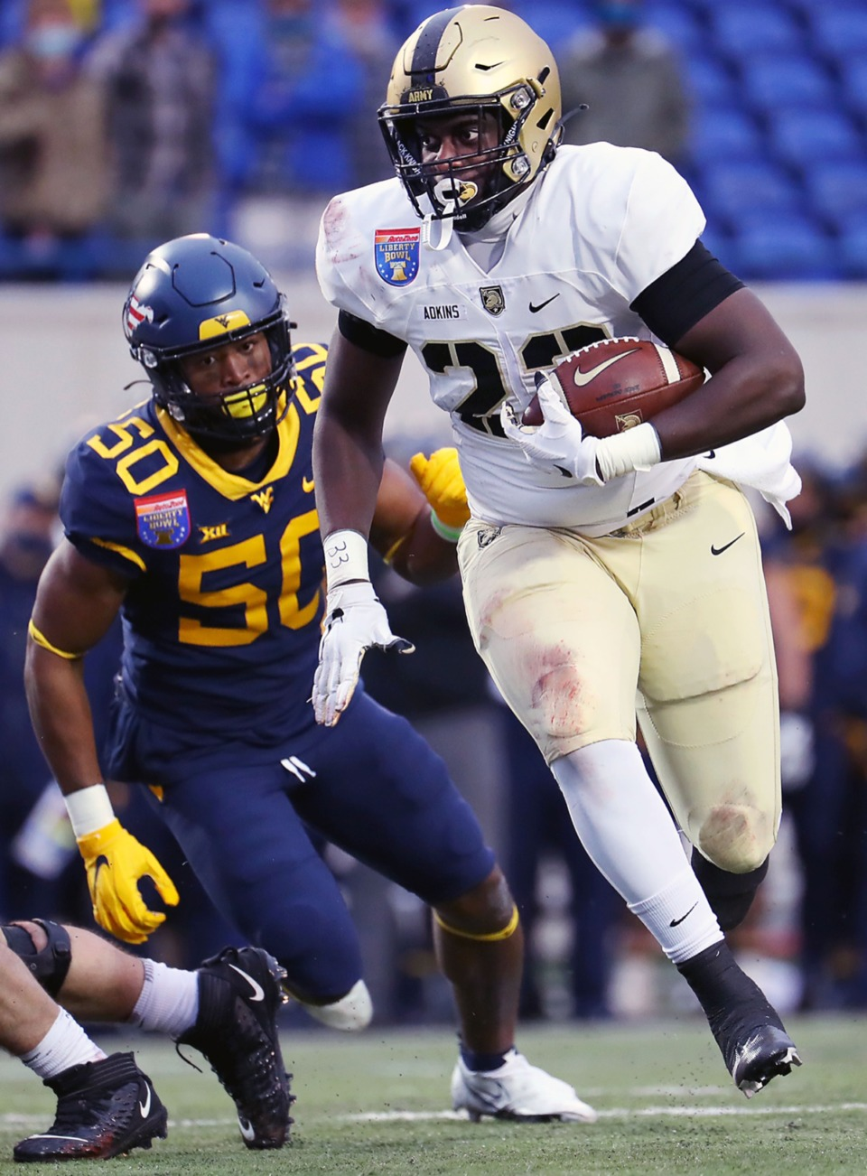 <strong>Army running back Anthony Adkins (23) rushes the ball during the AutoZone Liberty Bowl on Dec. 31, 2020.</strong> (Patrick Lantrip/Daily Memphian)