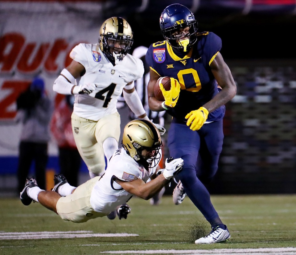 <strong>University of West Virginia receiver Bryce Ford-Wheaton (0) breaks a tackle in the AutoZone Liberty Bowl on Dec. 31, 2020.</strong> (Patrick Lantrip/Daily Memphian)