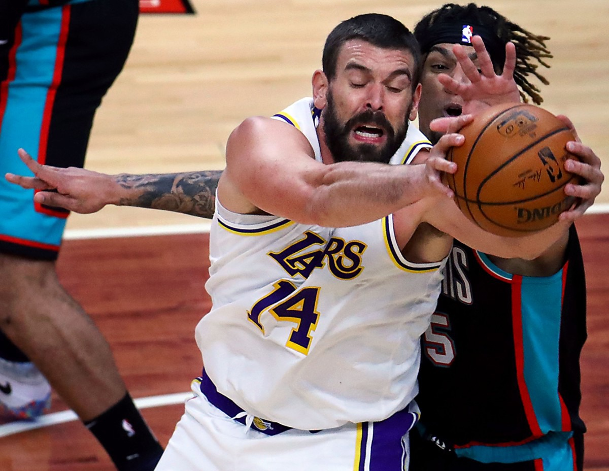 <strong>Memphis Grizzlies forward Brandon Clarke (15) fights for a rebound over Los Angeles Lakers center Marc Gasol (14) during a Jan. 3, 2021 game at the FedExForum.</strong> (Patrick Lantrip/Daily Memphian)