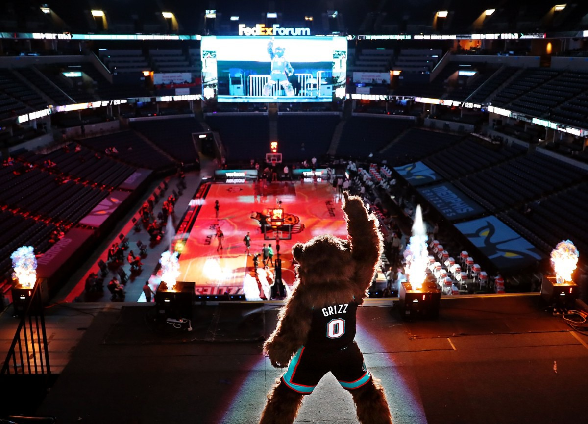 <strong>Grizz, the Memphis Grizzlies mascot poses in front of pyrotechnics in the nearly empty FedExForum before a Jan. 3, 2021 game against the Los Angeles Lakers.</strong> (Patrick Lantrip/Daily Memphian)