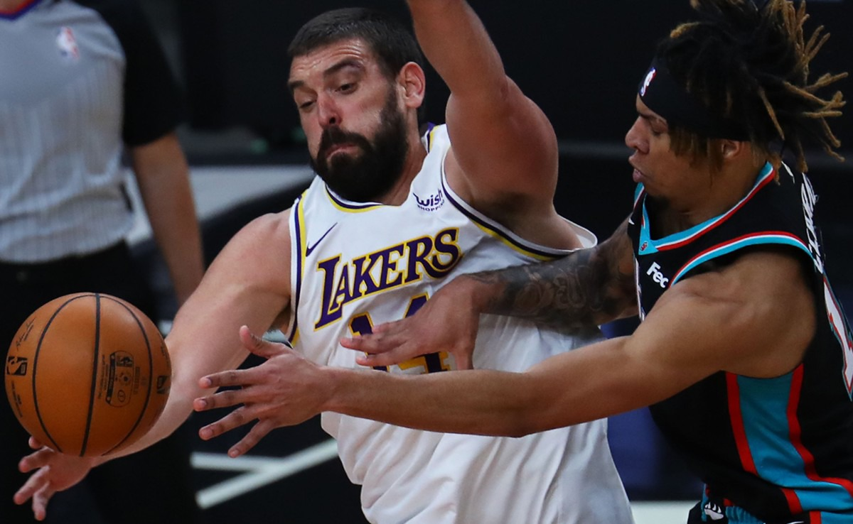 <strong>Los Angeles Lakers center Marc Gasol (14) tries to block the shot of Memphis Grizzlies forward Brandon Clarke during a Jan. 3, 2021 game.</strong> (Patrick Lantrip/Daily Memphian)