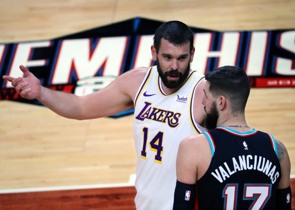 <strong>Los Angeles Lakers center Marc Gasol (14) talks to Memphis Grizzlies center Jonas Valanciunas (17) during a Jan. 3, 2021 game.</strong> (Patrick Lantrip/Daily Memphian)