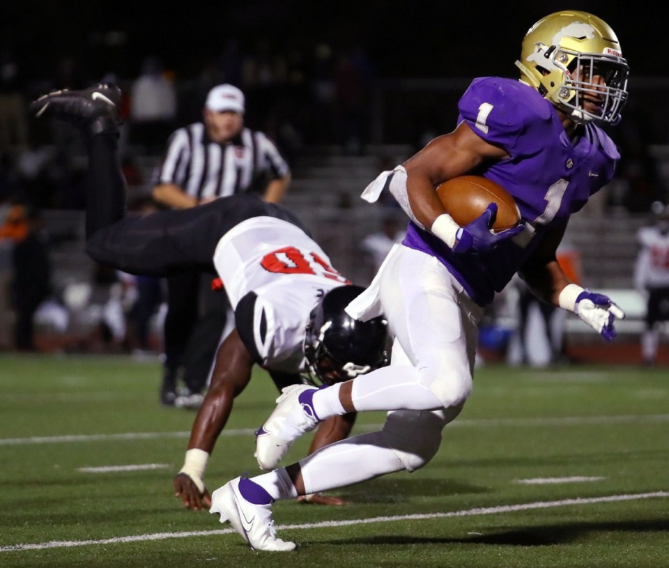 <strong>Christian Brothers running back Dallan Hayden (1) breaks a tackle during an October home game against Pure Youth Athletic Alliance. The Mr. Football winner has narrowed his college choices to Notre Dame, Ohio State, Oregon and Tennessee</strong>. (Patrick Lantrip/Daily Memphian file)