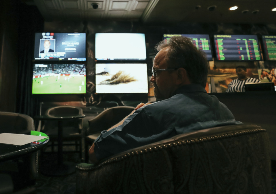<strong>A guest at Horseshoe Casino in Tunica places bets on football at the casino's new sports betting lounge. Mississippi was among several states that legalized sports betting last year. State Sen. Raumesh Akbari is sponsoring the Senate version of legislation authorizing sports betting in Tennessee.</strong> (Houston Cofield/Daily Memphian file)
