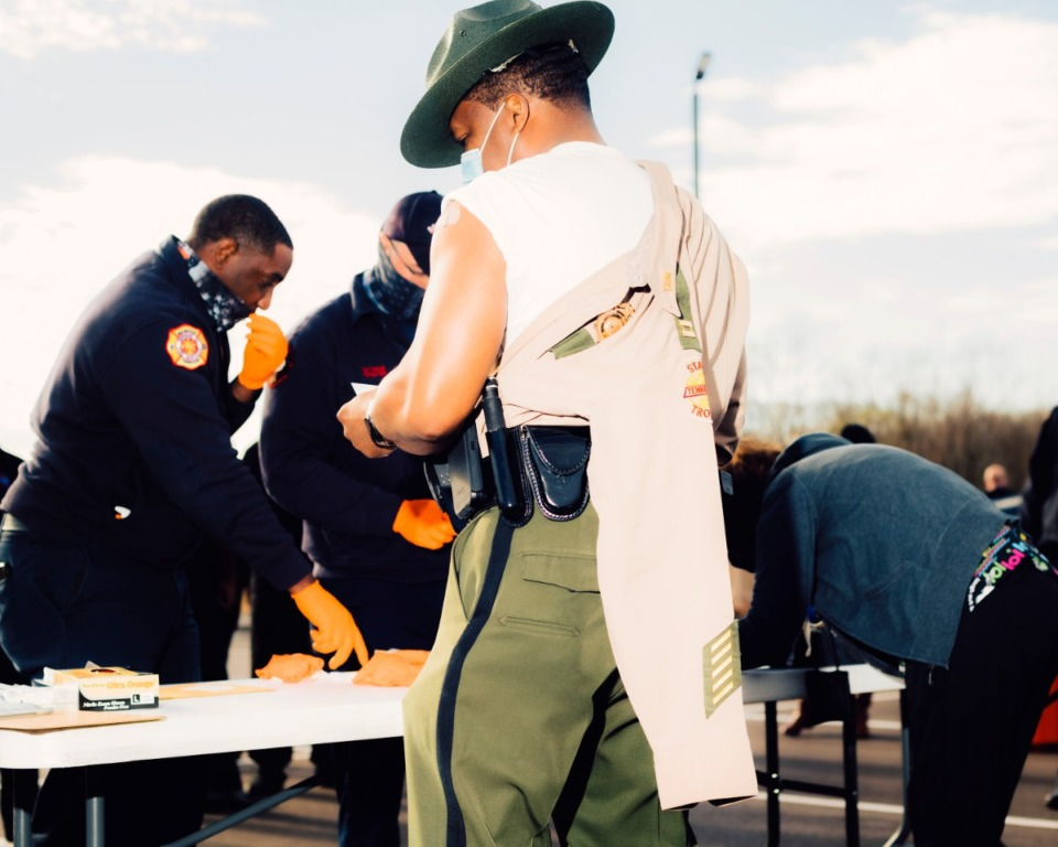 <strong>A Shelby County state trooper pulls an arm out of his shirt as he prepares to receive a coronavirus vaccination. Health care workers and first responders were among the first to receive the vaccine on Monday, December 28, 2020</strong>. (Houston Cofield/Special To The Daily Memphian)