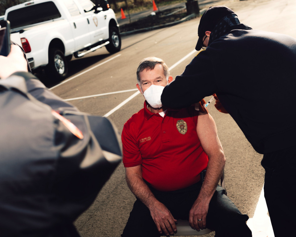 <strong>A member of the Memphis Fire Department receives the coronavirus vaccination on Dec. 28.</strong> (Houston Cofield/Special To The Daily Memphian file)