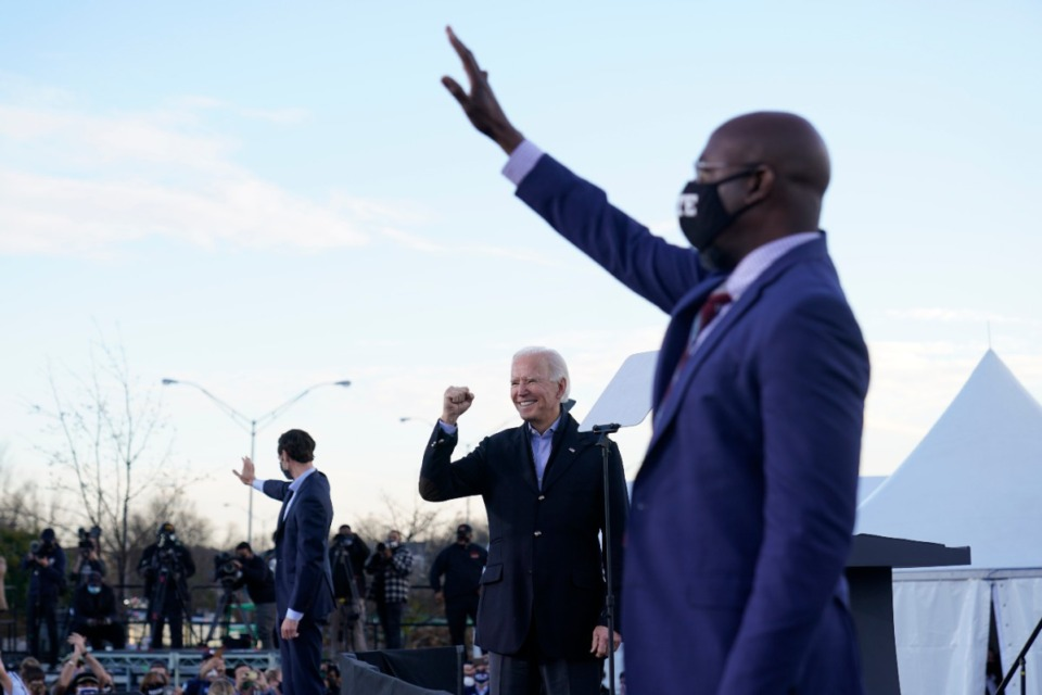 <strong>President-elect Joe Biden campaigns in Atlanta, Monday, Jan. 4, 2021, for Senate candidates Raphael Warnock, right, and Jon Ossoff, left.</strong> (Carolyn Kaster/AP file)