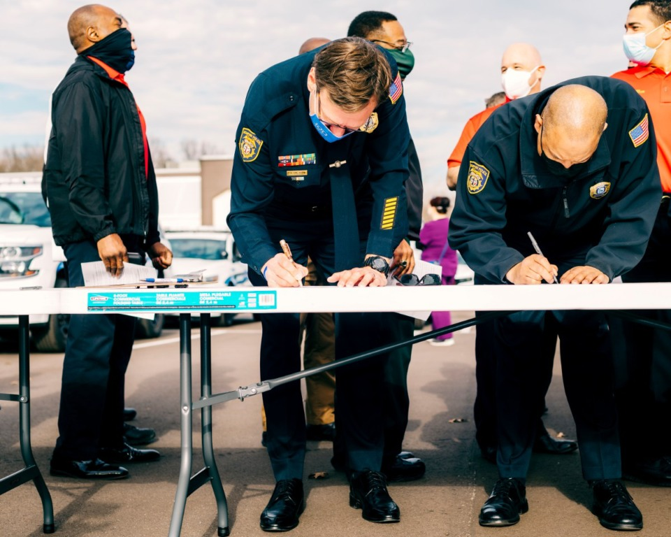 <strong>Members of the Memphis Police Department fill out forms before taking the coronavirus vaccine. Health care workers and first responders were among the first to receive the vaccine on Monday, December 28, 2020.</strong> (Houston Cofield/Special To The Daily Memphian)