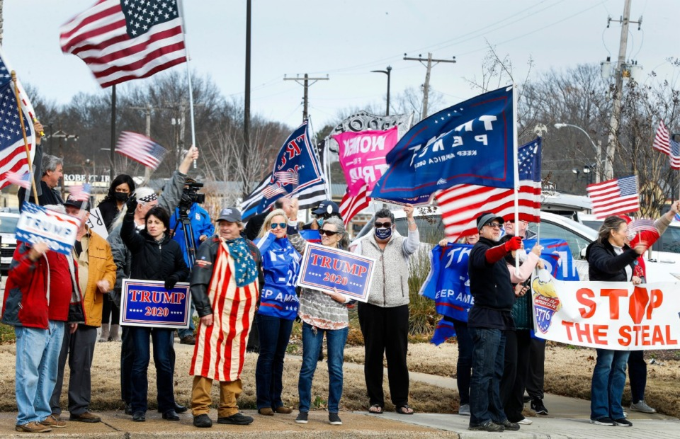 <strong>Local Trump supporters hold a rally on Wednesday, Jan. 6, 2021, at Poplar and Perkins, on the day that Congress convenes to accept the vote for president from the Electoral college.</strong> (Mark Weber/The Daily Memphian)